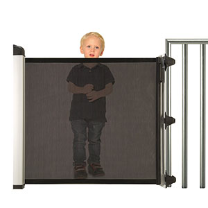 KiddyGuard Avant Boy standing behind closed gate Bannisters