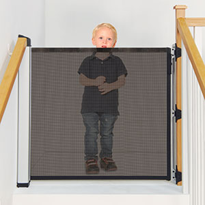 KiddyGuard Avant Boy standing on top of stairs closed gate Bannisters