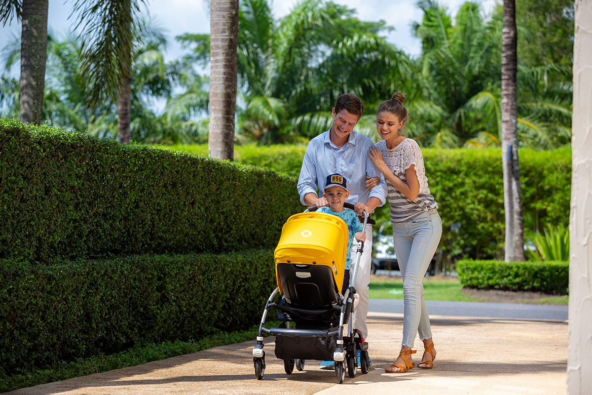 BuggyBoard Maxi, parents with kids walk in the park 01